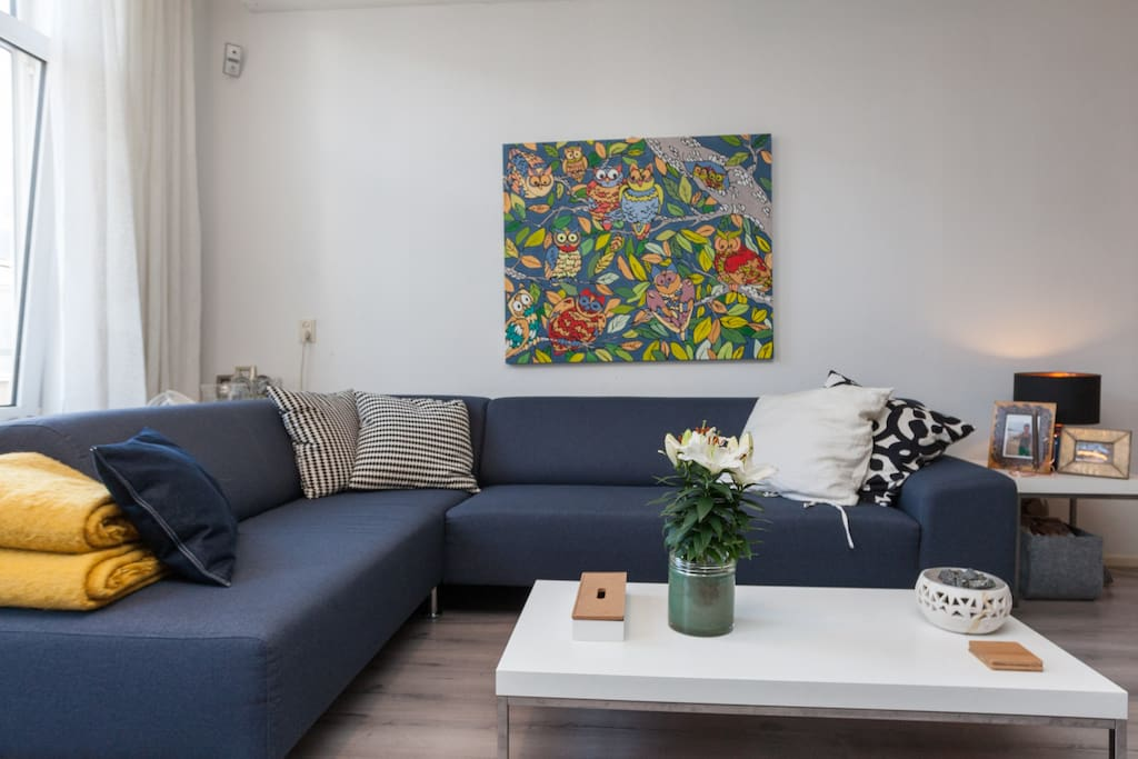 A luxurious two bedroom apartment Rotterdam center   The sofa, big enough for four people, and if you need more, there are two more lounge fauteuils.