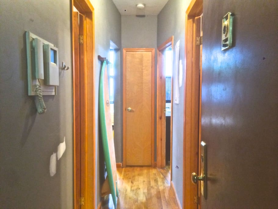 The bright entry hallway welcomes you into my home, leading to both bedrooms on the right and the bathroom, living/dining room and kitchen on the left.