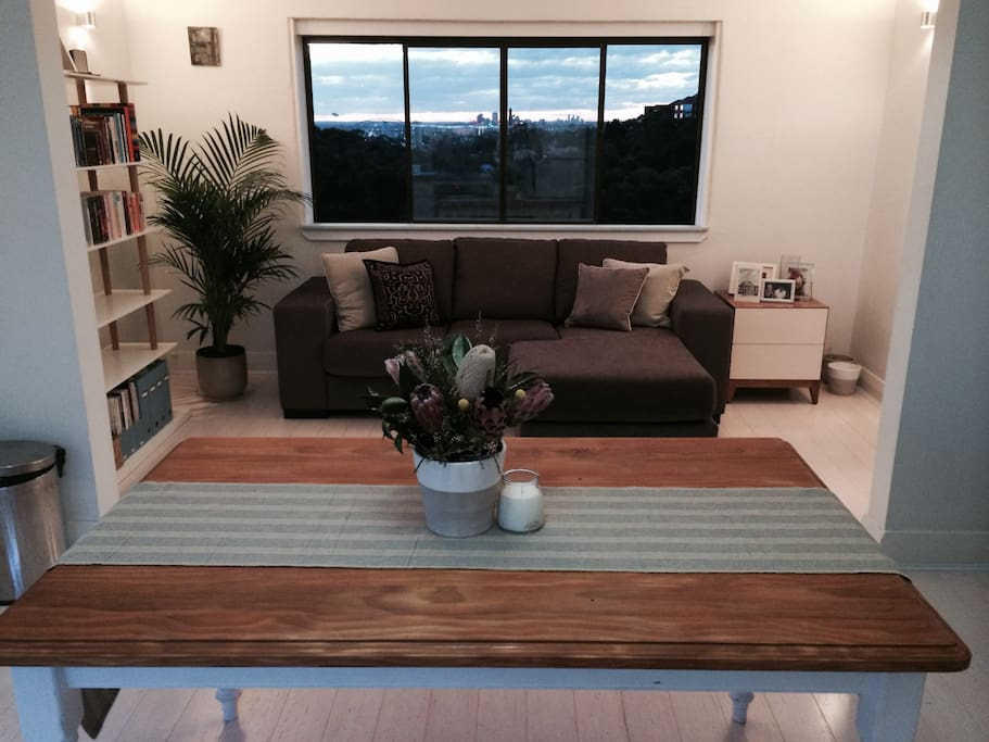 open plan living area with beautiful leafy outlook and views of the City and harbour bridge! Gorgeous at night when the city lights are tuned on.