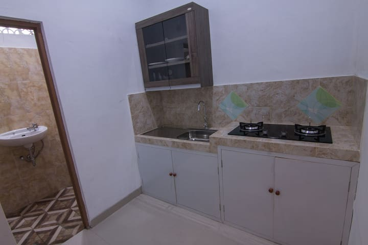 A kitchenette with standard dining set