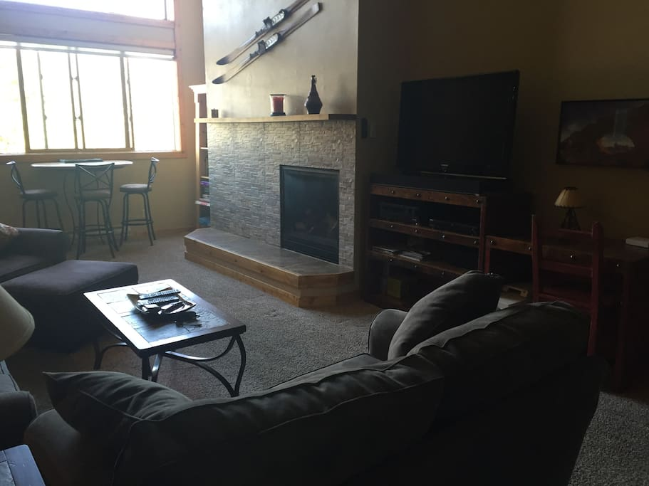 "Large great room with new gas stone fireplace, new furniture, 46"" flat screen, Bluetooth sound system"