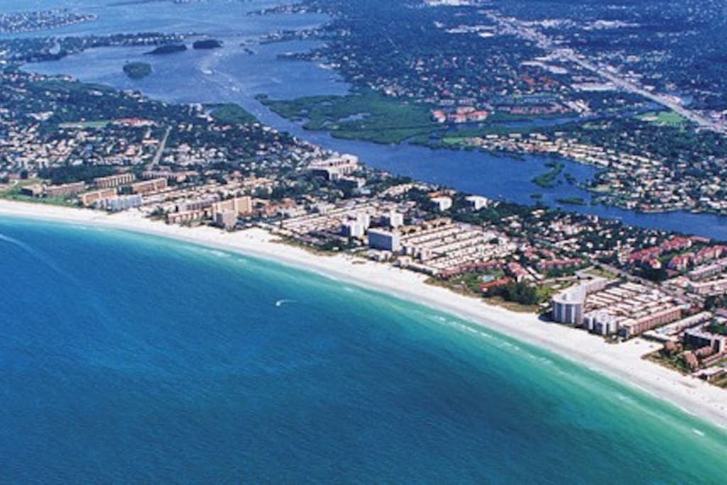 Aerial view of Siesta Key with Crystal Sands in the bottom right corner (curvy, white building).