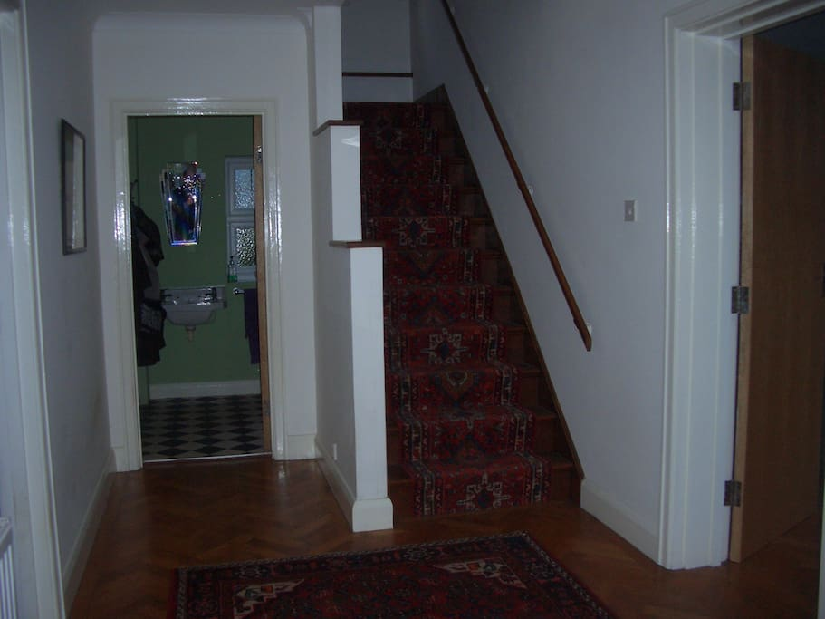 This is your first view on coming through the front door: the hallway and stairs which lead to your room which is off the landing on the first floor.