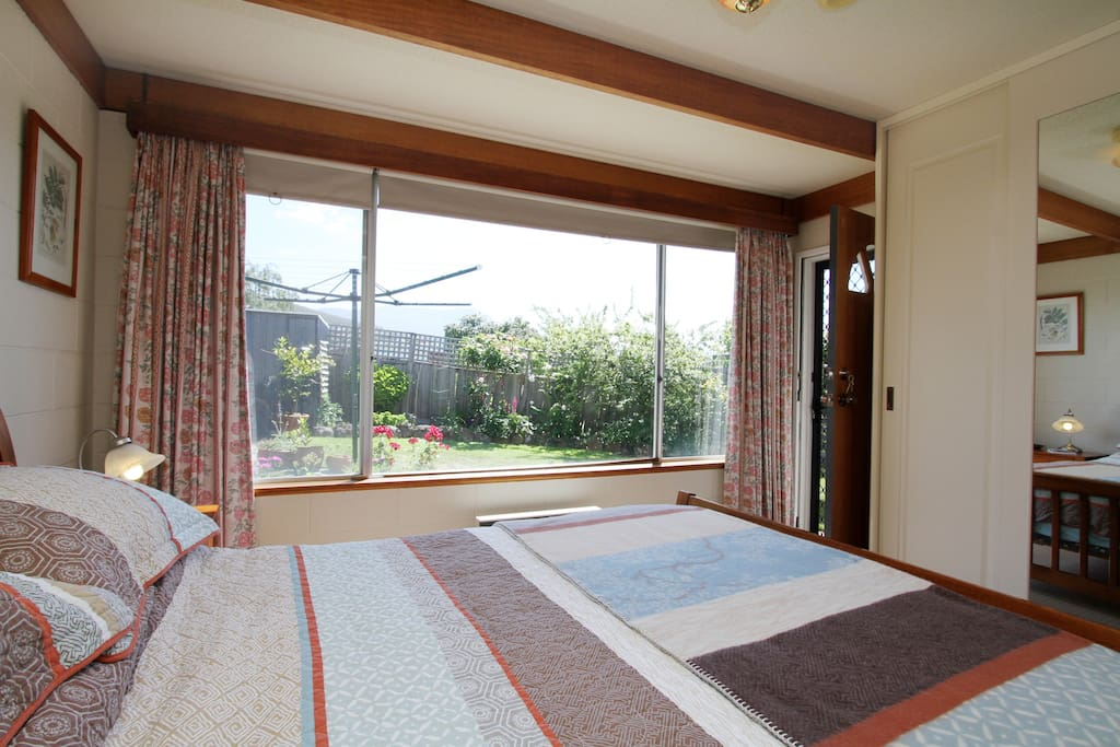A comfortable queen size bed. Private entrance. View to Mt Wellington...