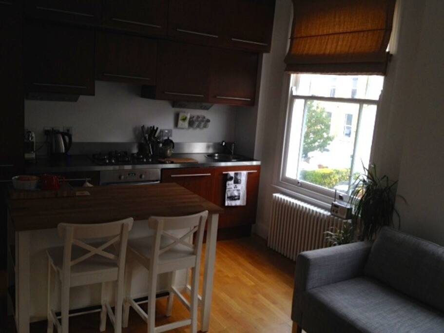 Fully equipped kitchen with dishwasher and washing machine.