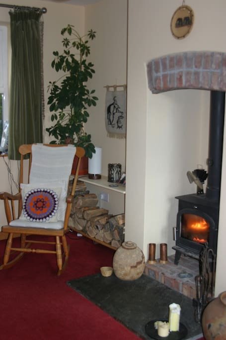 A cosy corner of the sitting room by the woodburner.