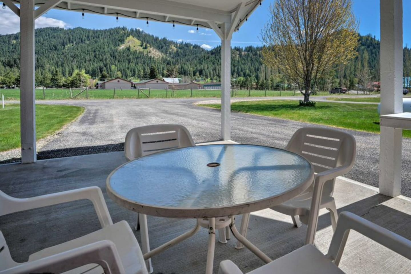 Covered sitting area with chairs for six make for a great place to enjoy a beverage or meal outside.