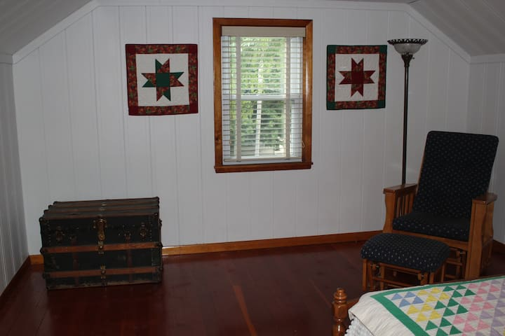 Upstairs bedroom with full size bed.
