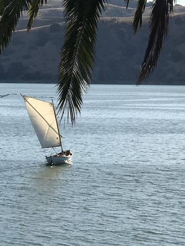 Watch sailboats  and activities happening on the water right from your room