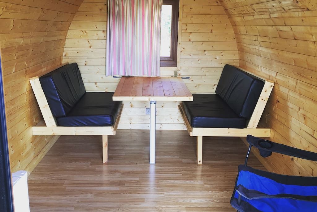 inside the cabin, table fold into a double bed