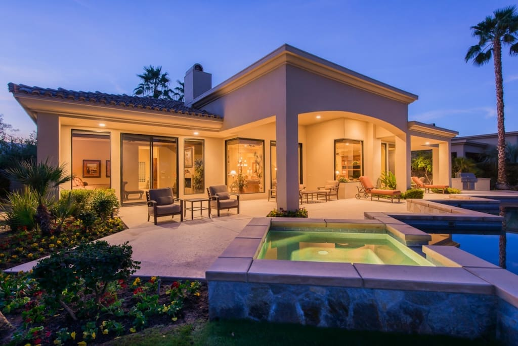 Back of Home at Night with Spa and Patio