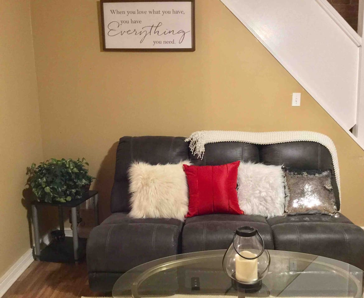 This hidden gem cozy living room area has a comfortable sofa and fireplace to relax in.