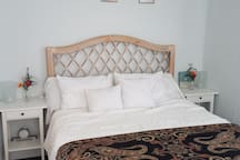 Queen size bed with premium sheets.