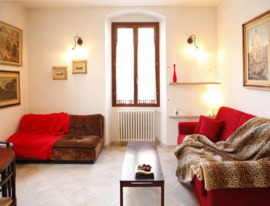 Soggiorno (divano-letto) - Living room (with 1 fold-out sofa) - Sala de estar (com um sofa-cama)