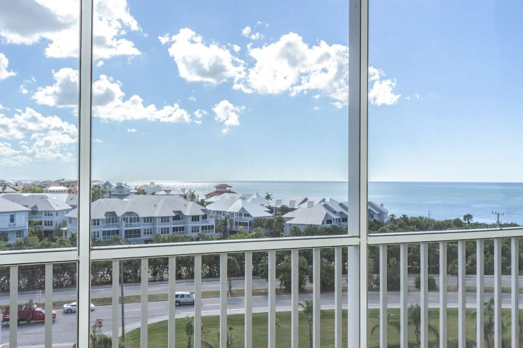 While sitting on the lanai, you'll enjoy this stunning view of the Gulf, and the million dollar homes along Barefoot Beach.