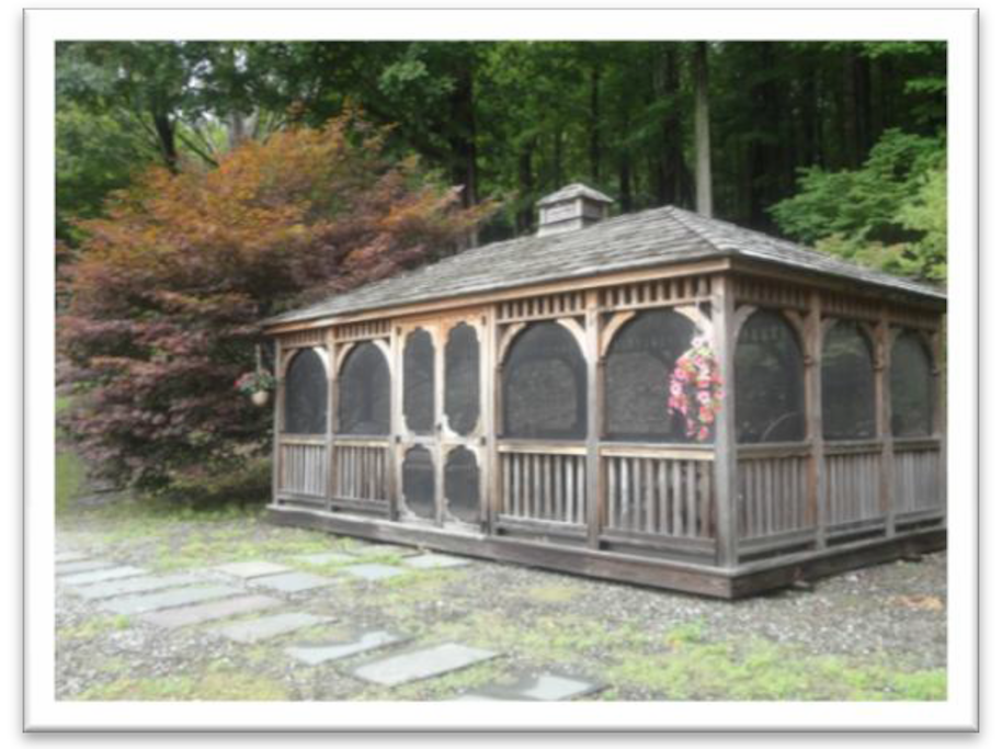 Screened-in gazebo complete with grill, card table, interior & exterior lighting, picnic table and chairs.