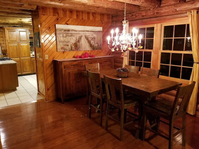 Separate dining area with buffet table.