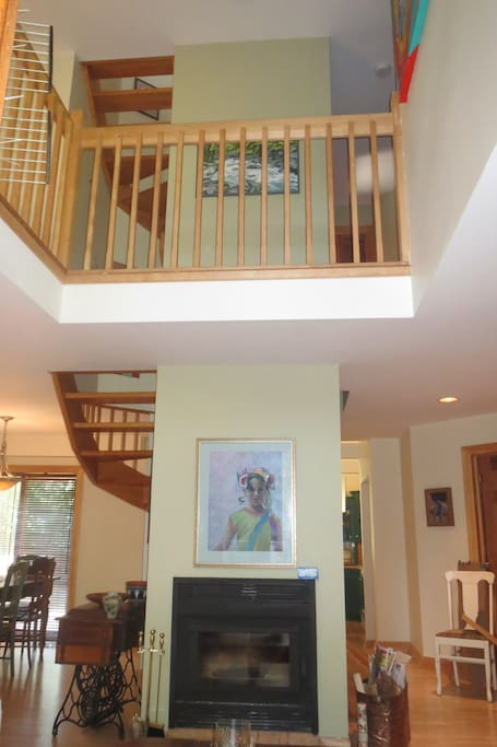 Double spiral staircase in the center of the house, encases the high efficiency wood stove
