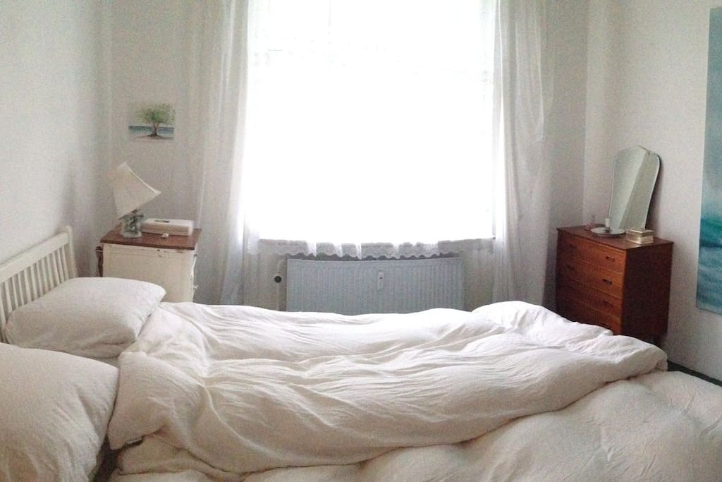 The bedroom has the morning light