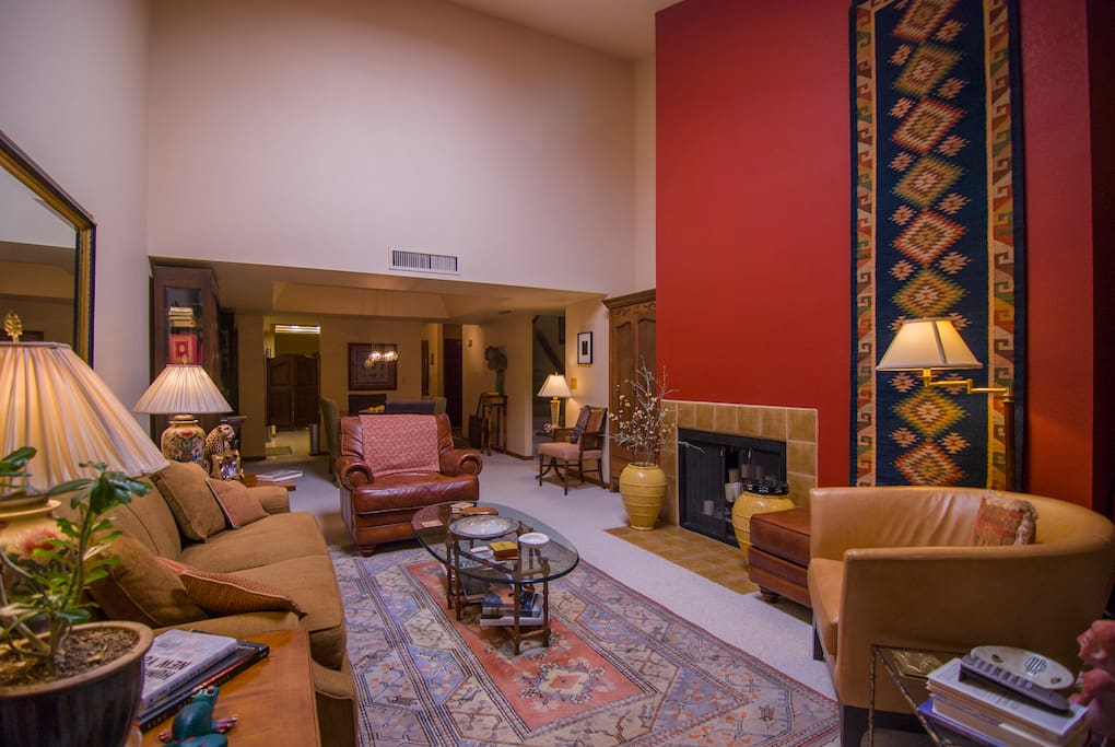 Comfortable seating and fireplace provide a cozy setting.