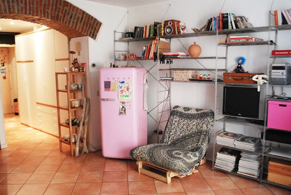 living room and pink fridge