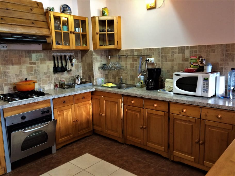 Fully functional kitchen that provides:  - gas hob with 4 burner  - electric oven  - fridge  - microwave  - dishwasher  - various kitchen equipment for cooking and serving food - various types of plates, cutlery, glasses, mugs, etc.