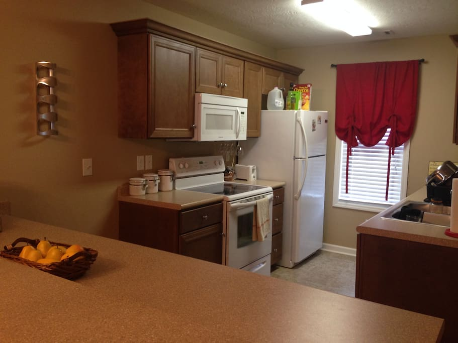Big spacious kitchen equipped with microwave and stove.