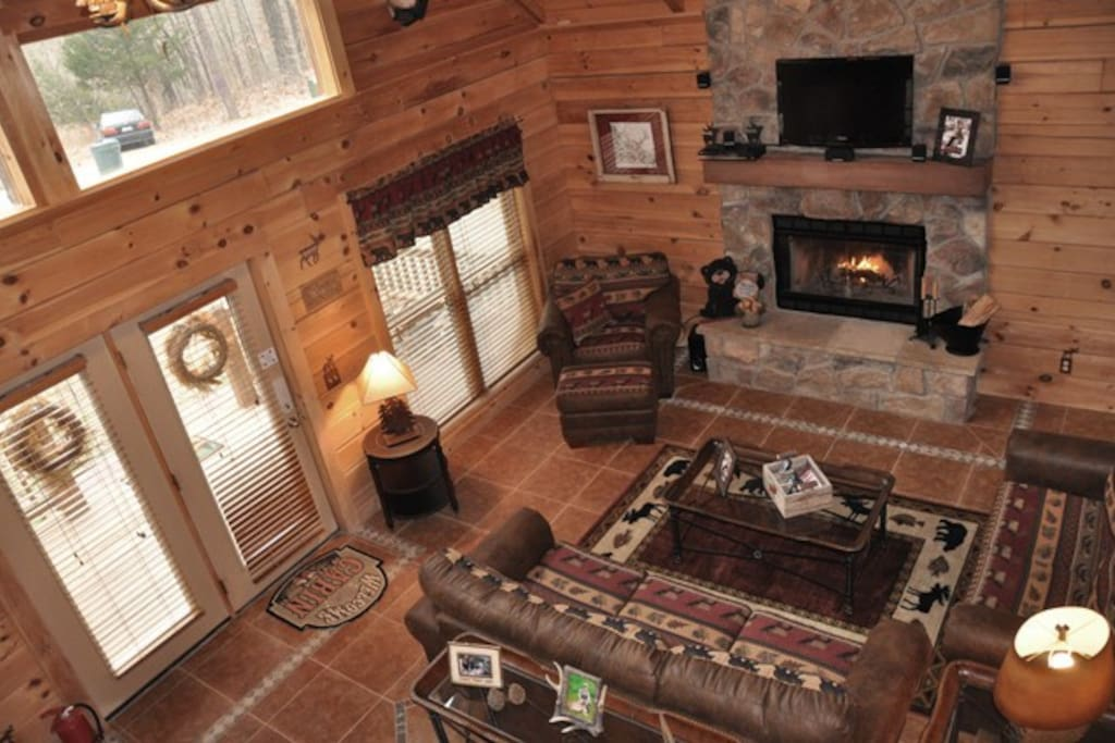 Welcoming living room with many windows and wood burning fireplace