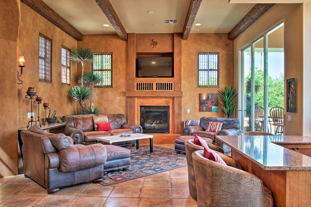Kick back and relax while staying warm by the fireplace in the living area.