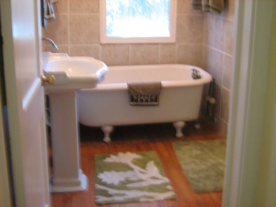 tub with walk in shower to your right..tiled to the top of the wall all over
