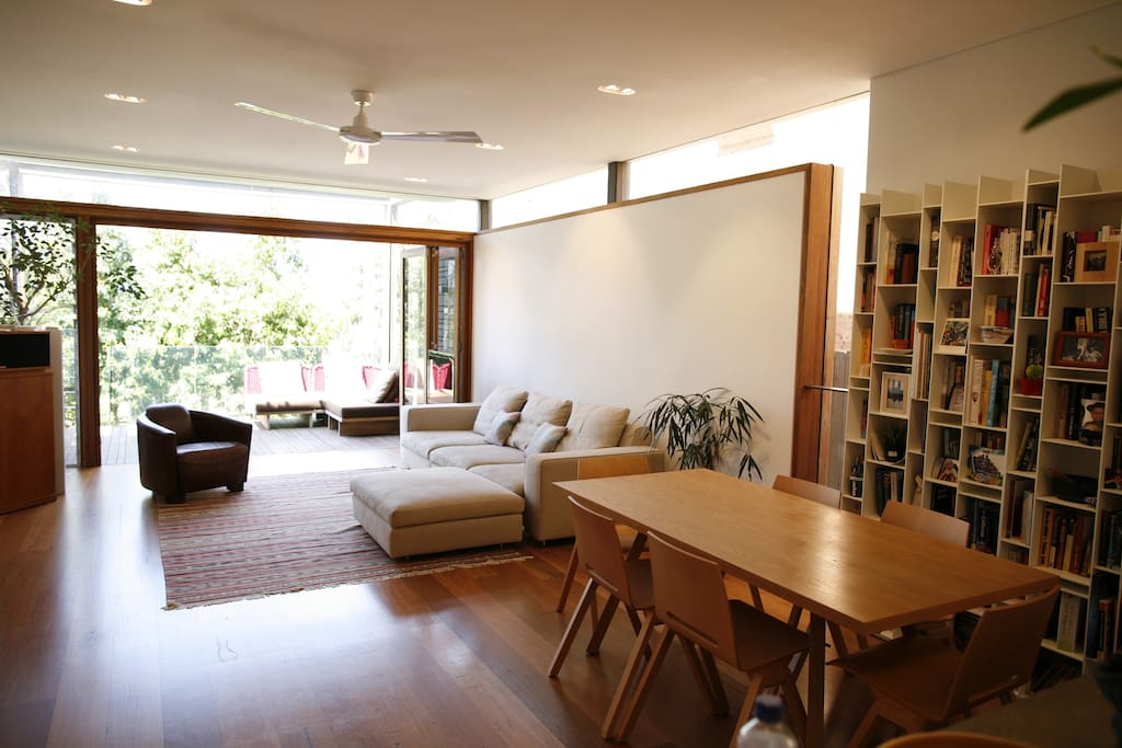 Downstairs living and dining area leading to deck and garden