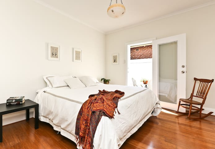 Bedroom 2: King bed that can be split into singles - Access to outdoor courtyard...