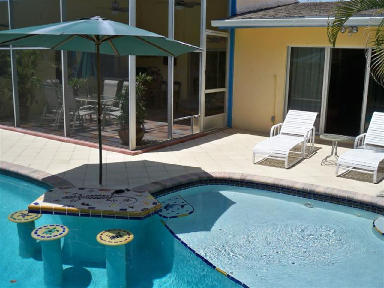 "Swim up bar stools and table, 15"" deep sun deck, holds two chaise lounges!"