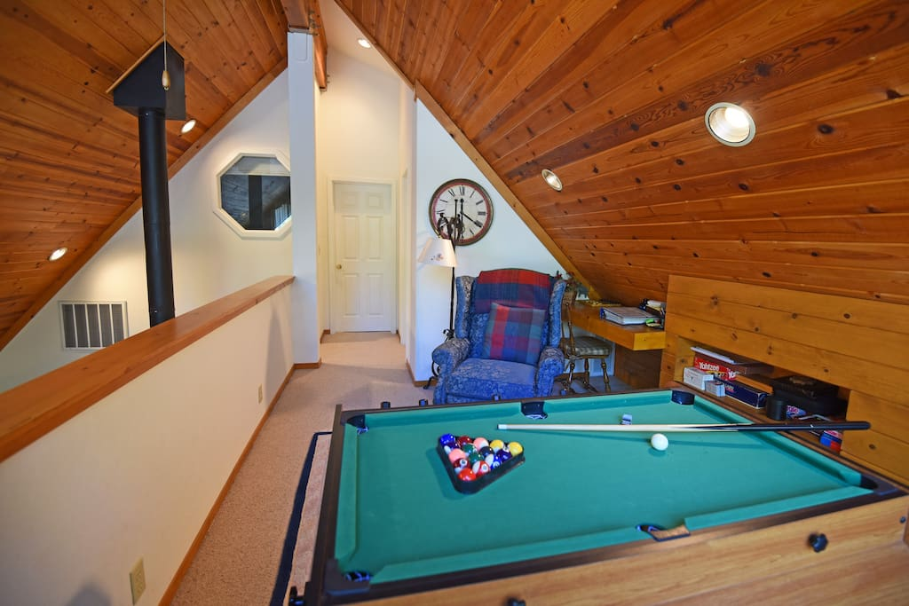 Upstairs pool table for guests to enjoy on nights at the home