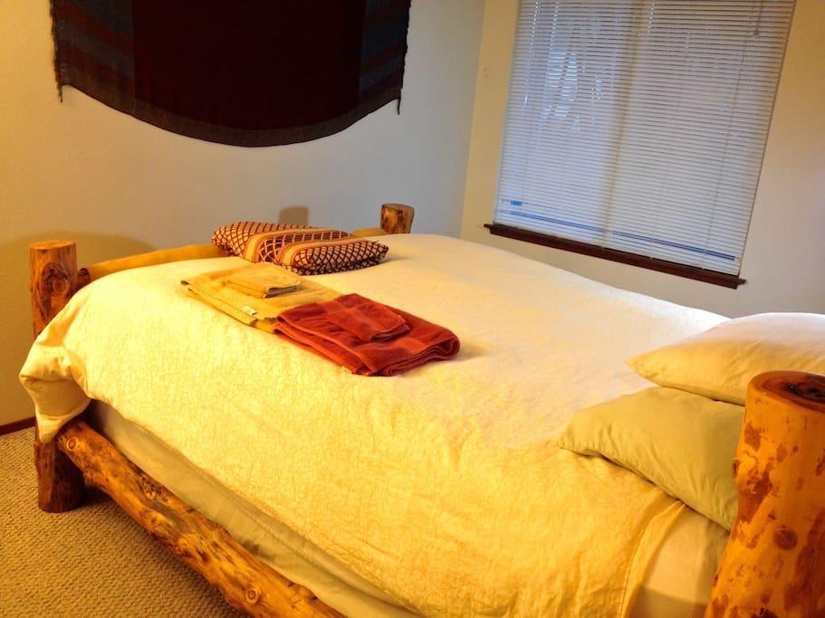 Aspen log bed in master bedroom