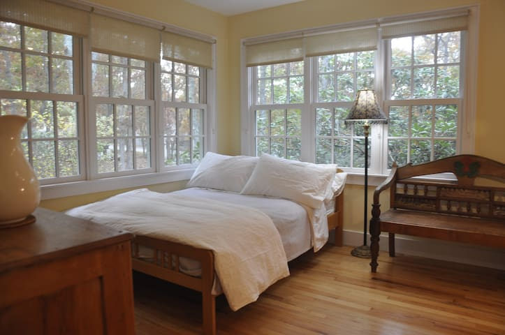 Bright corner bedroom with library on 1st floor.