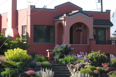 A charming stucco house located right opposite Greenlake, Seattle Washington, one of the most popular neighborhoods in Seattle.  I often tell people I live at a resort -- biking, swimming, roller blading, boating -- right outside the front door.
