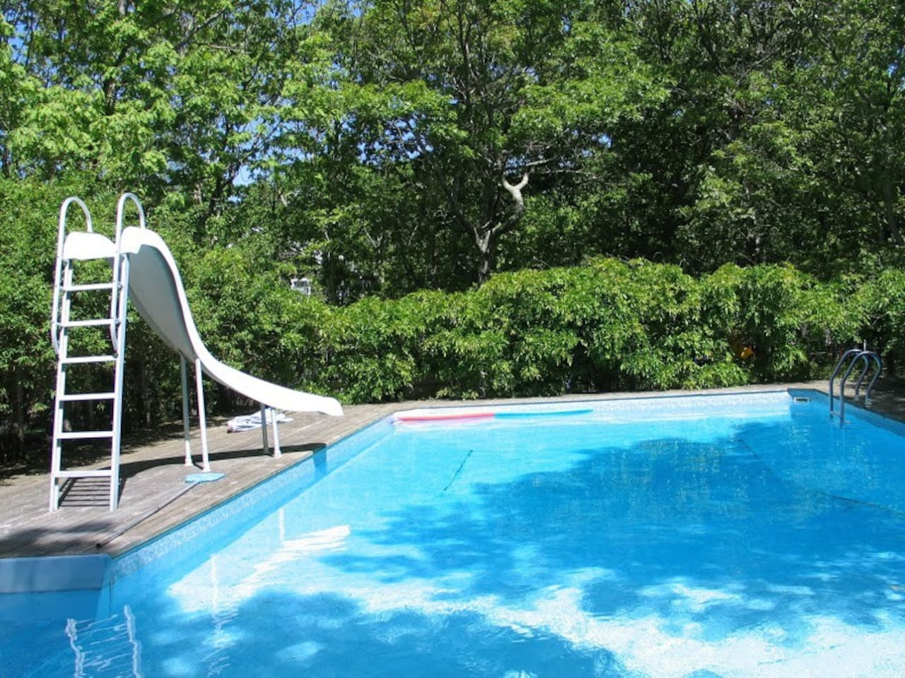 Heated swimming pool (20x40) with water-slide and child-proof fence.