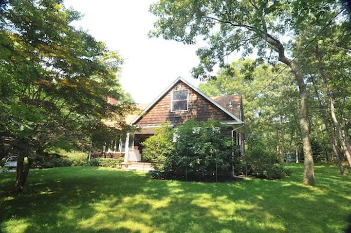 Cape cod house on one acre of beautifully landscaped land for privacy.