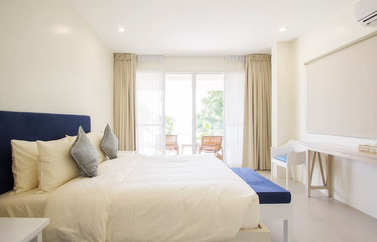 Ouano Beach House (Room 2) - Seaview, Balcony, Queen bed