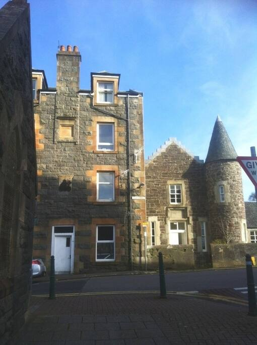 Flat on bottom right, beside lovely Scots baronial style listed building.