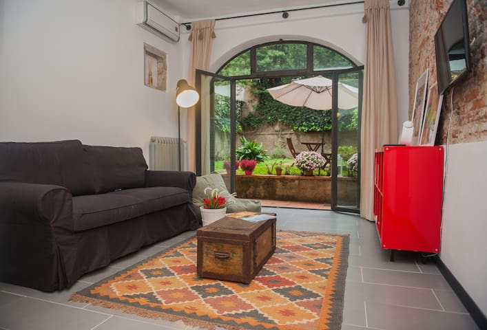 Living area with the double sofa bed and real matress of 140 cm. Enjoyable  awakening in the morning facing directly on your private and secure garden. If you prefer  darkness do not worry you have big tent