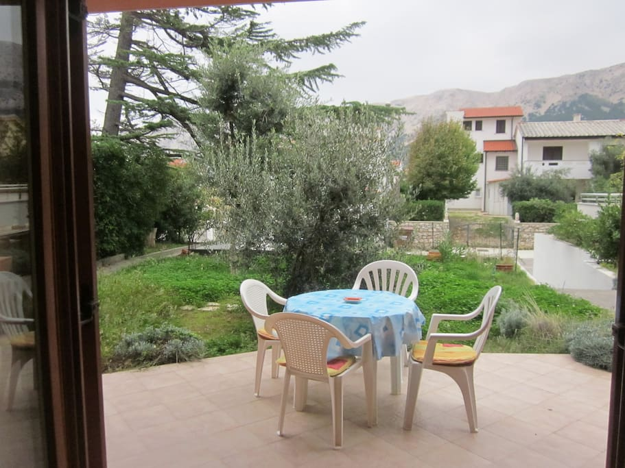 View from the apartment terrace  with access to  the garden