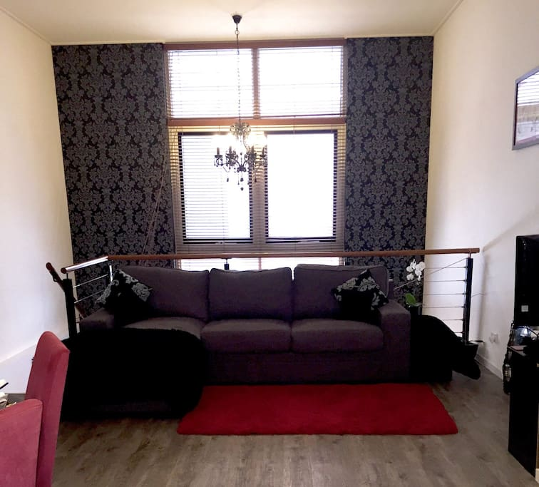 """""""The listing was exactly as described and just how we imagined, we definitely felt pleased as punch with our swanky pad for the weekend!""""- Jo - Lounge room with sofa bed, TV, Netflix and laneway view"""