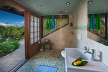 Travertine bath with natural stone and European fixtures