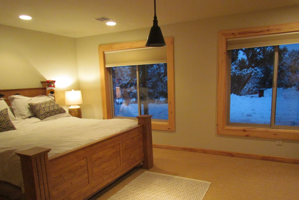 Cozy bedroom with king-size bed, excellent natural light and views to nature in golf course.