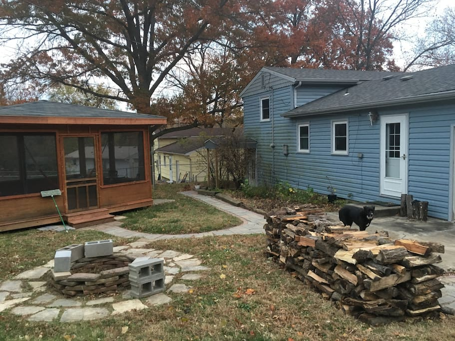 Back yard: screened-in porch, firepit, kitchen door.