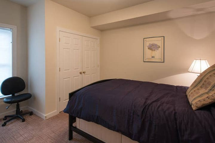 Queen Size Bed in airy quiet bedroom. The bedrooms are above ground, with large windows and lots of natural light.