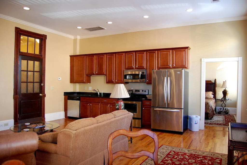 Stainless steel appliances in kitchen with cherry wood furnishing.