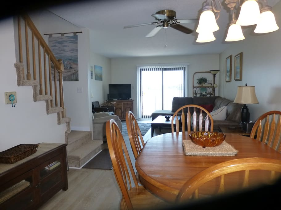 Living room and dining room area with deck overlooking the Assawoman Bay in Ocean City